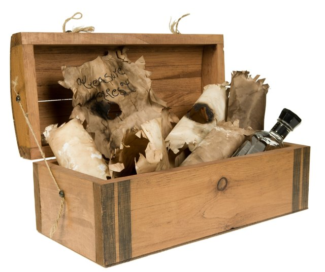 Open cedar pirate chest with contents