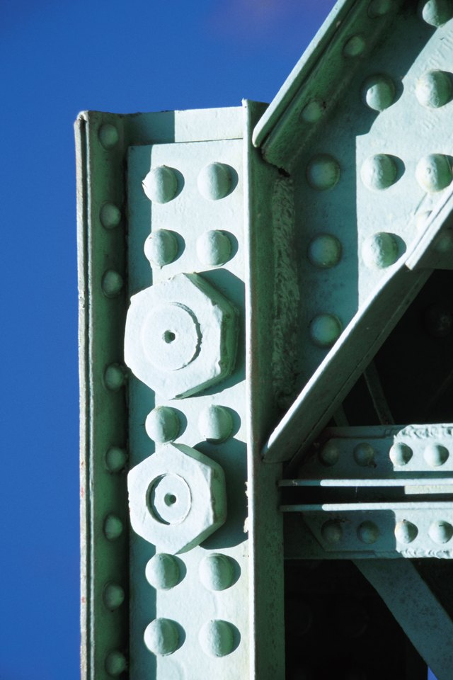 Nuts and bolts in steel girders with rivets