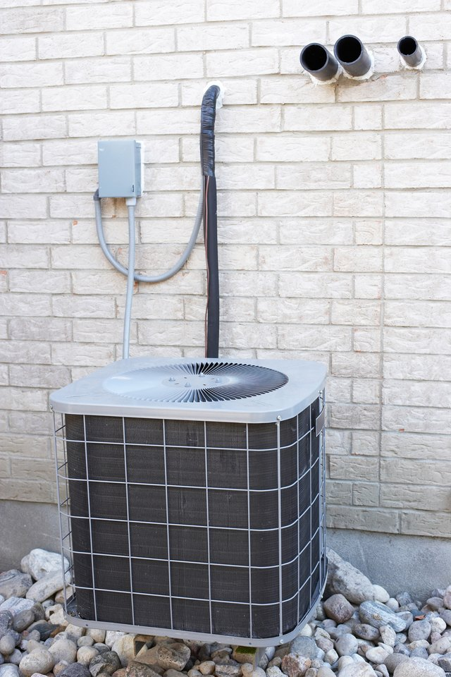 Air conditioning unit on building exterior