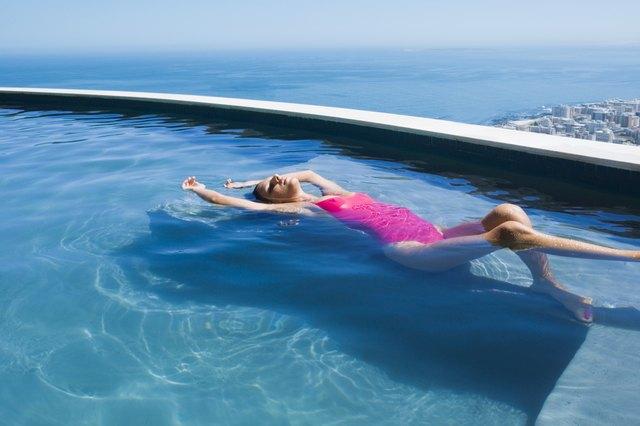 Woman lying in a pool