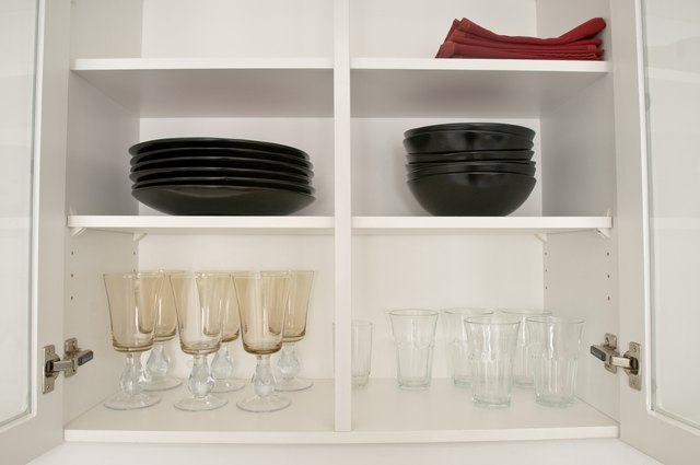 Open kitchen cabinets with dishes and glasses
