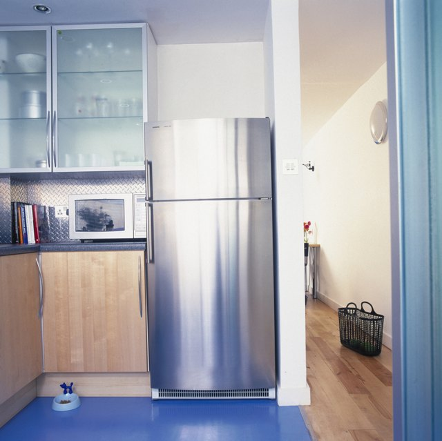 View of a modern kitchen with a steel finish fridge