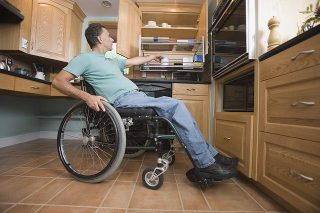 Man using wheelchair in kitchen