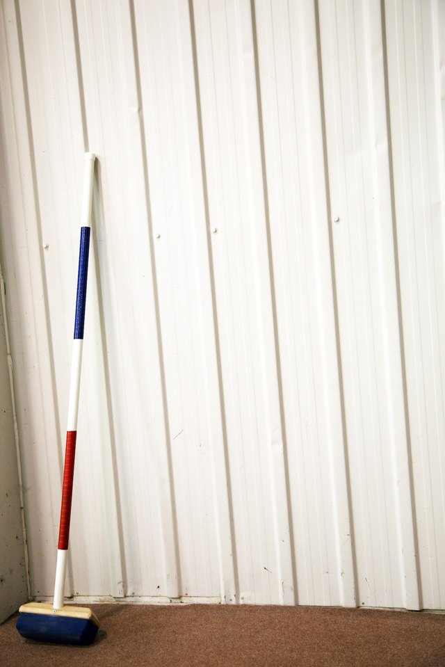 Curling broom on wall