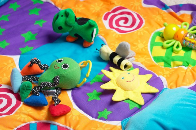 Baby toys on colorful blanket