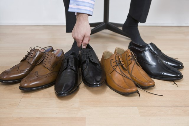 Man with variety of footwear
