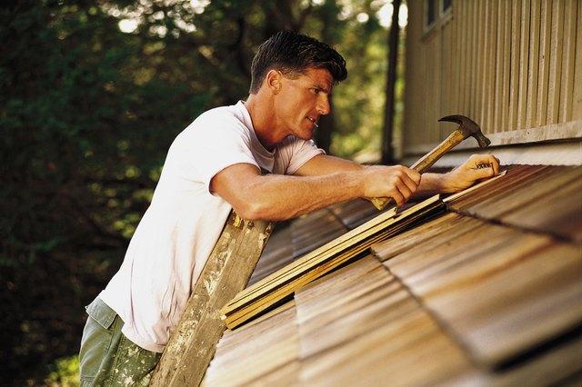 Man installing roof shingles