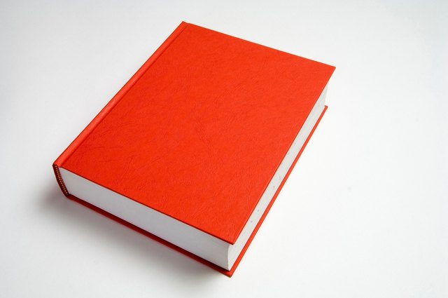 Blank red book on white.