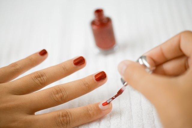 Painting fingernails with nail polish