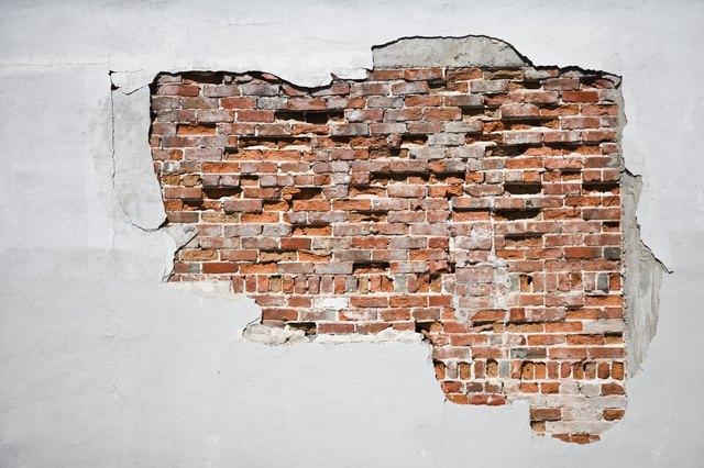 How to create faux exposed brick wall using venetian plaster stone veneer hunker for Brick veneer for interior walls