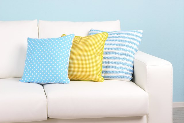White Sofa Close Up In Room On Blue Background
