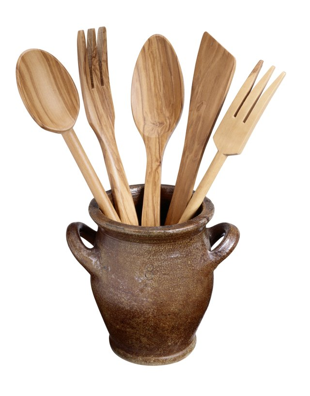 Clay Pot with Wooden Spoons and Forks