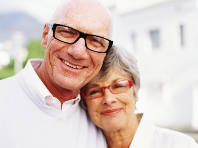 Senior couple wearing spectacles, smiling, portrait