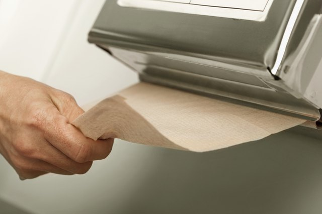 Healthcare worker pulling out paper towel in hospital
