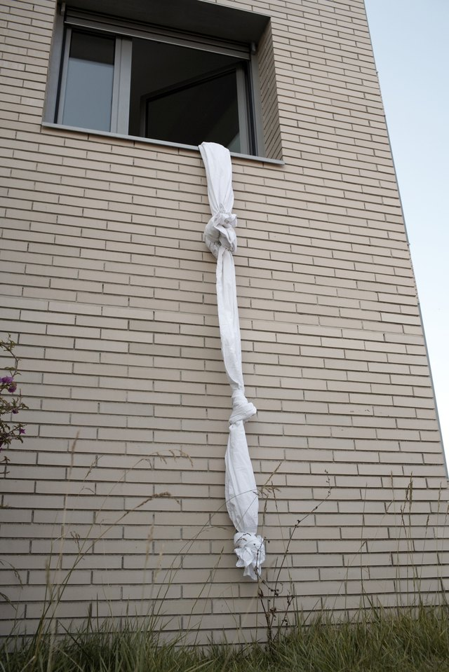 sheets tied to create a rope out of a window