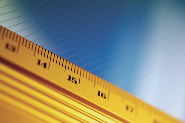 Close-up of yellow ruler against blue and white background