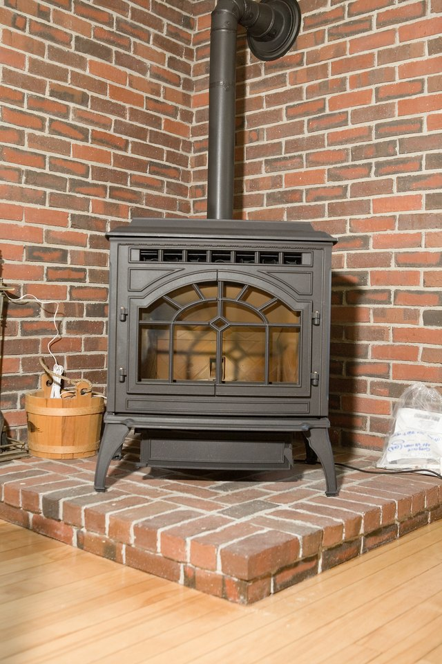 Wood stove in brick corner & How to Hook Up a Wood Stove Through the Basement Window | Hunker