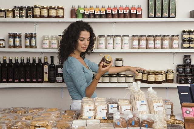 Shopkeeper stocking shelves