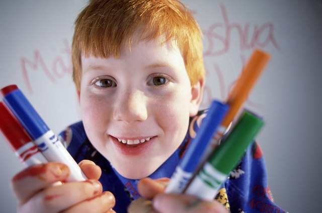 Boy with markers