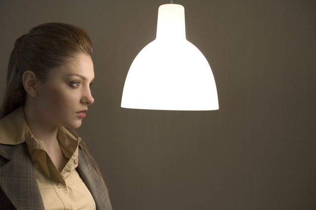 Woman looking at light fixture