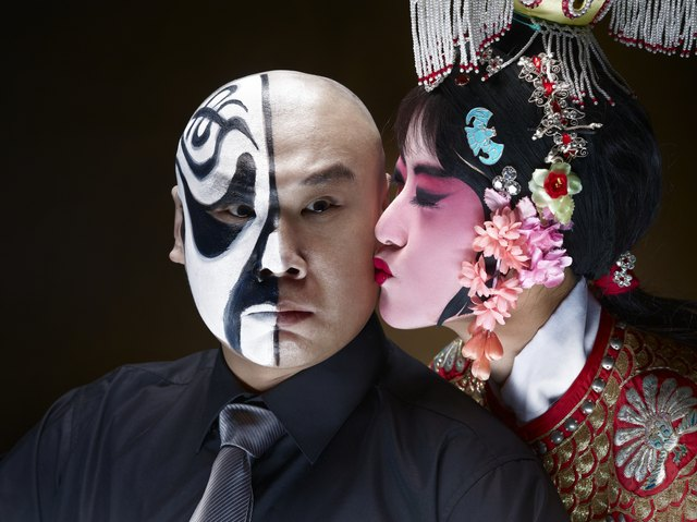 Female Chinese opera singer kissing male actor