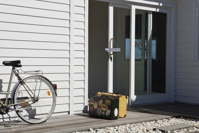 Bicycle and luggage at beach house