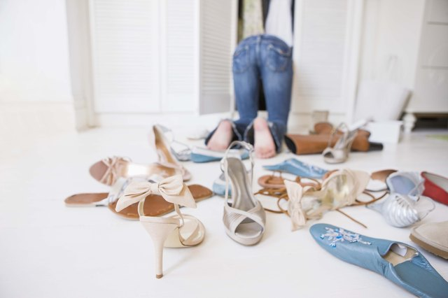 Woman searching for shoes in closet