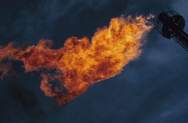 Gas flame flaring from vent at refinery