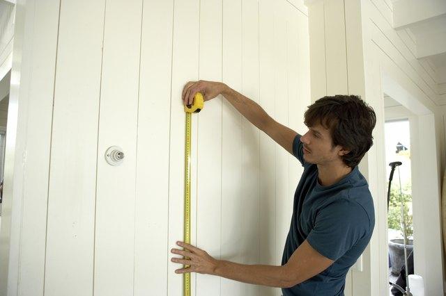 Man measuring socket height