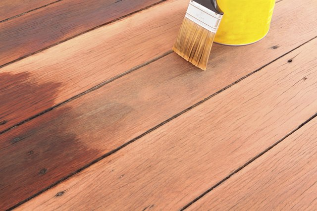 brush tin and decking oil for a timber deck