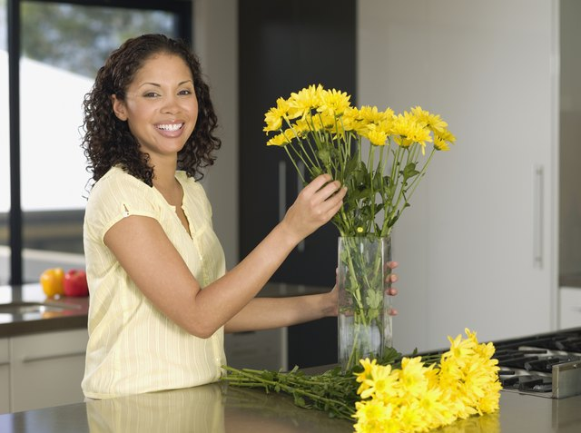 Mixed Race woman arranging flowers