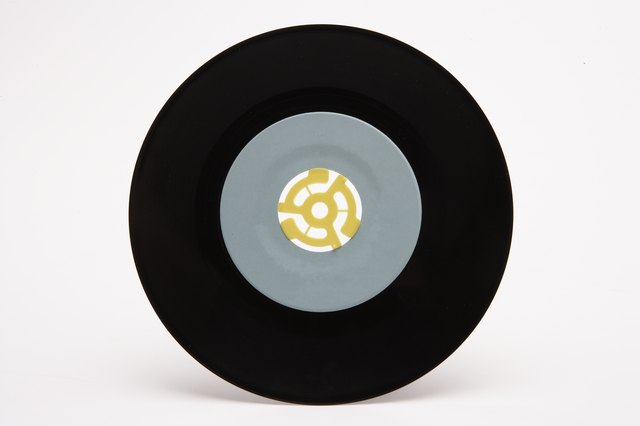 7-inch record with plastic 45-rpm adapter in center