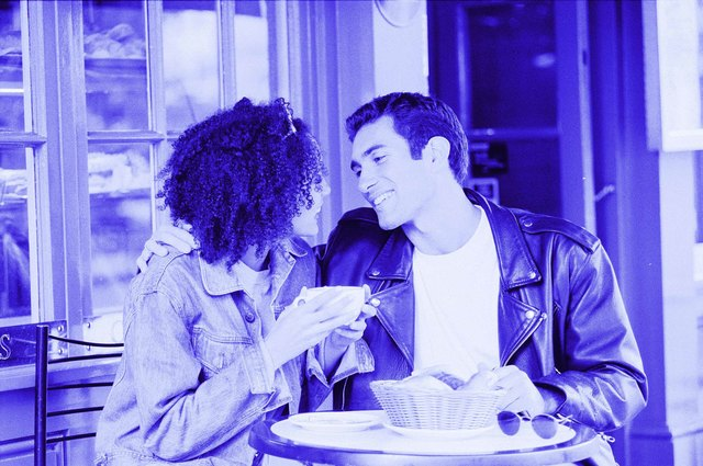 Hispanic male and African American female in cafe
