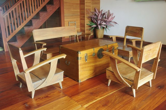 teak wood console table and armchair on wooden floor