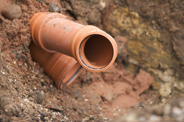 Sewer Pipe Being Installed In Ground