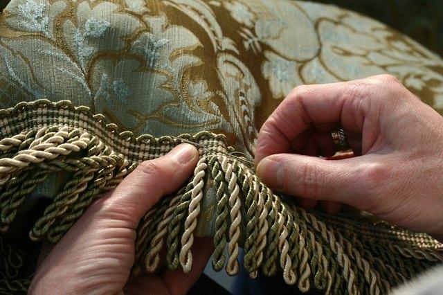 Sewing fringe to a drape