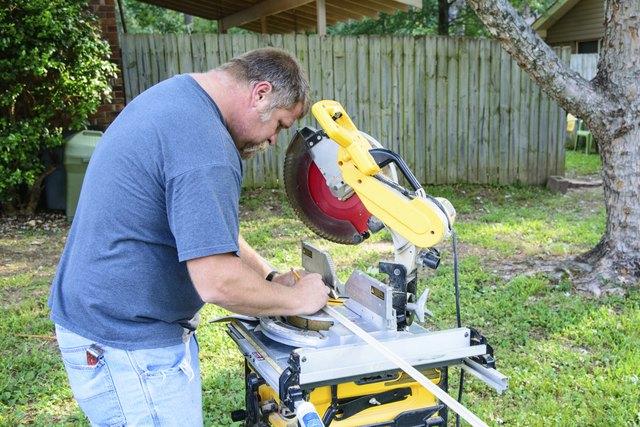 Man using power miter saw