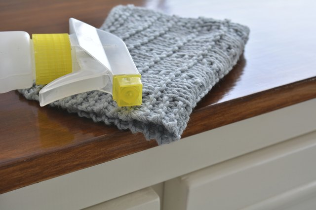 Blue wash cloth with spray cleaner