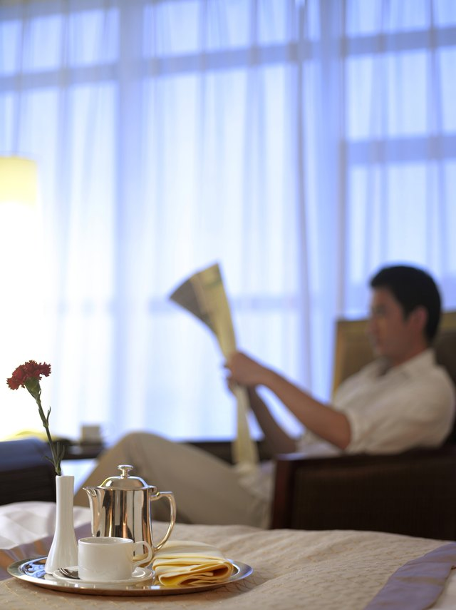 Room service tray, man reading newspaper