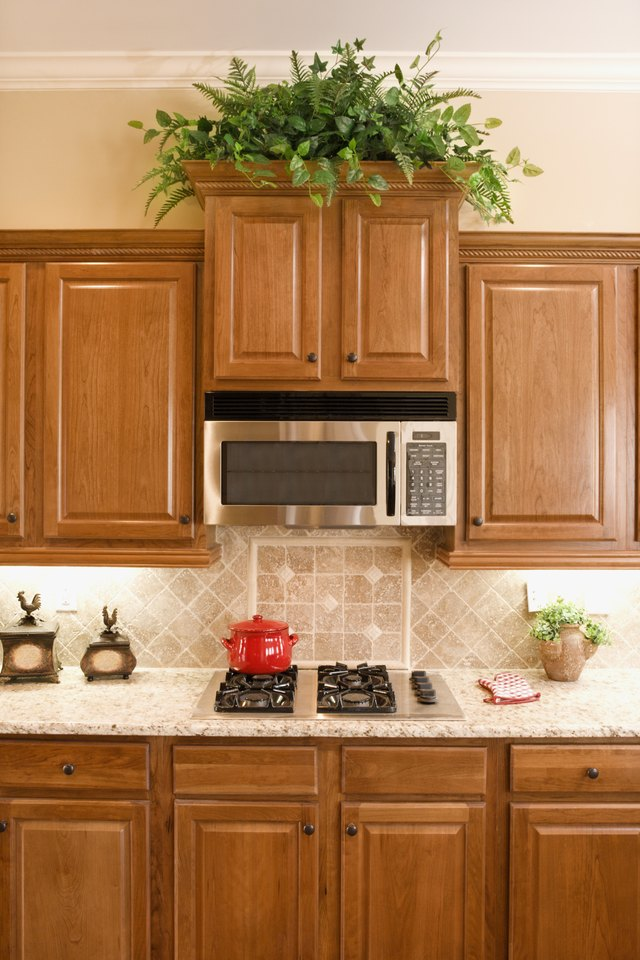 What Color Granite Countertops Go With Light Maple ... on Countertops That Go With Maple Cabinets  id=76362