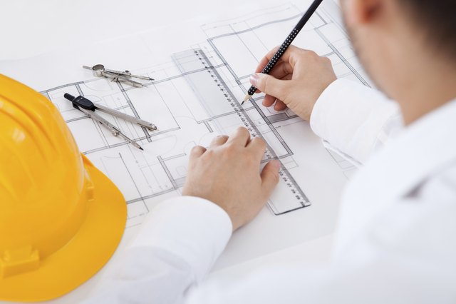 Architect working on blueprints