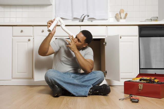 Man sitting on floor with pipe