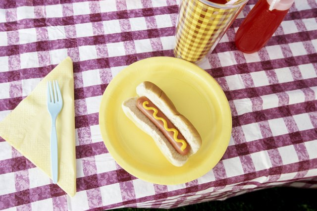Hot dog on plate on picnic table