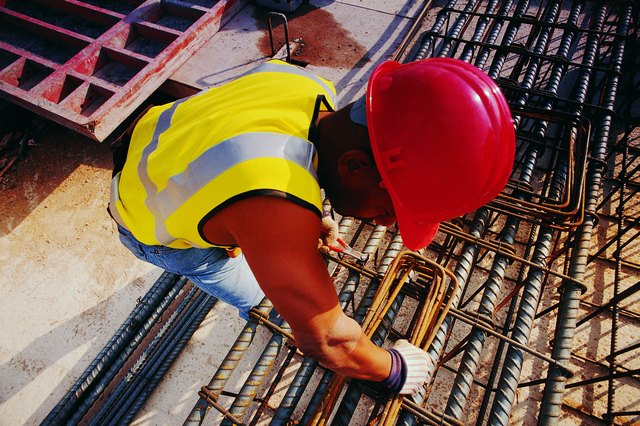 Overhead shot of worker with rods