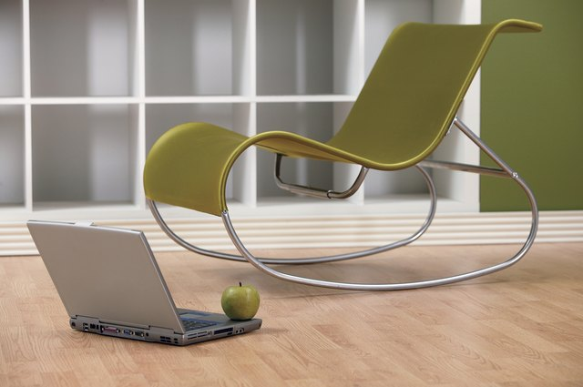 Modern Chair with laptop and apple