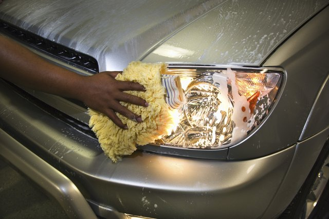 Hand cleaning headlight of car