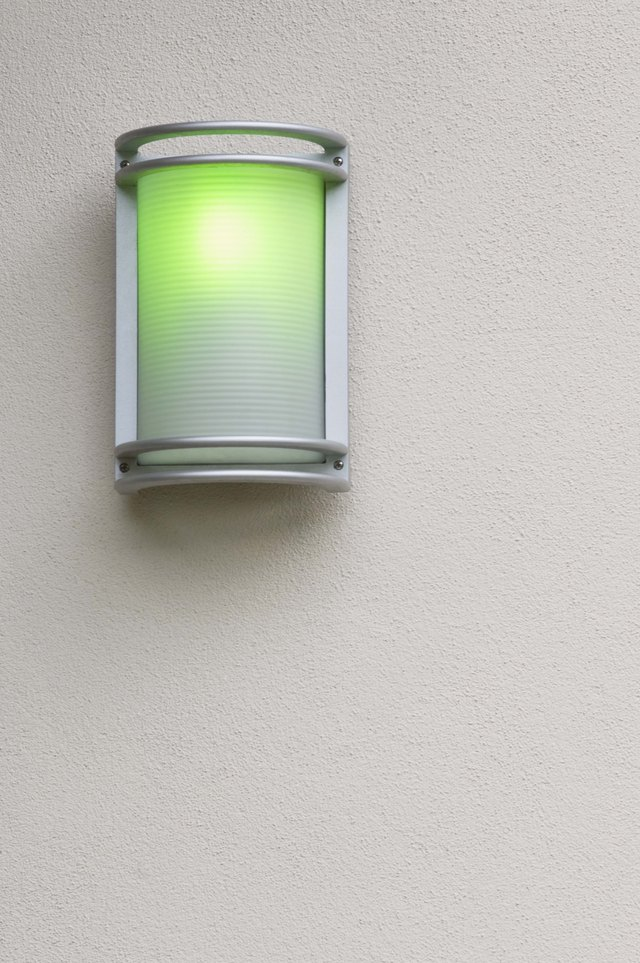 Wall sconce with green light