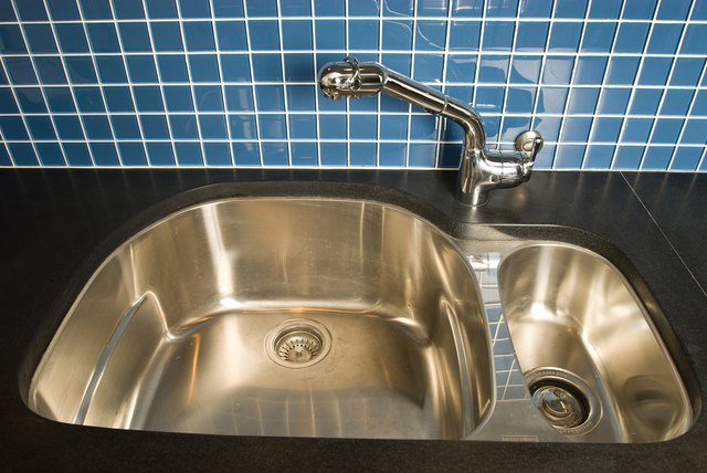 High angle view of kitchen sink by tiled wall