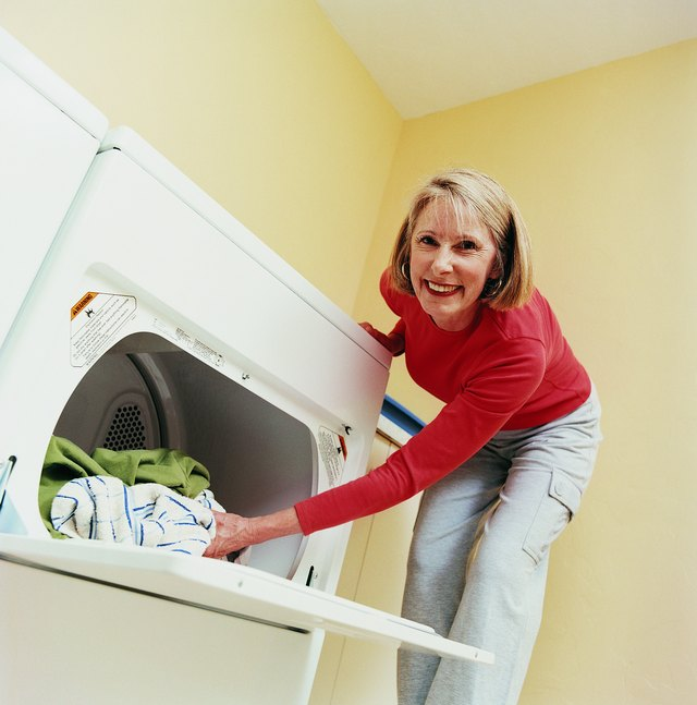 Mature Woman Emptying a Tumble Dryer