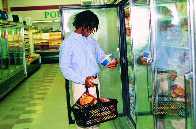 Man looking at frozen foods in grocery store